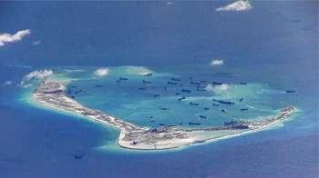 Laut Cina Selatan: Kapal perang AS berlayar dekat pulau buatan