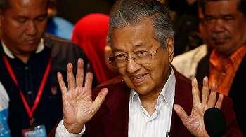 Pemilu Malaysia: Oposisi pimpinan Mahathir Mohamad unggul sementara atas Barisan Nasional